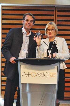 The Globe and Mail's VP advertising sales Andrew Saunders and strategy magazine executive editor Mary Maddever present a Next Media Star at last year's AToMiC event.