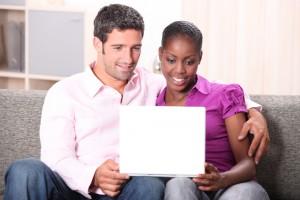 couple wathing laptop video
