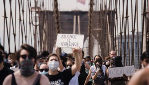crowd-of-protesters-holding-signs-4614166-623x350