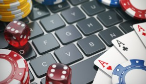 Casino,Online.,Gambling,Chips,,,Cards,And,Dice,On,Laptop